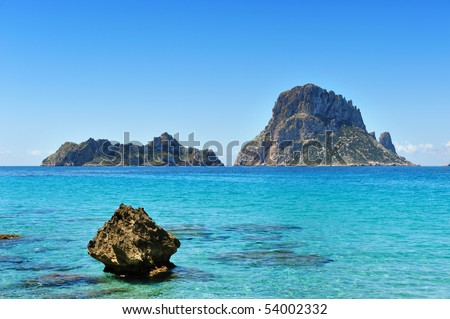 The islands and turquoise waters Es Vedra Cala d'Hort Ibiza Spain