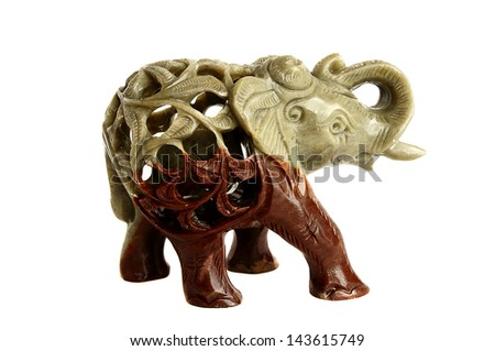 The isolated figurine of an elephant from a stone on a white background