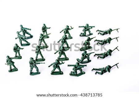 The isolated image of a group of plastic toy soldiers