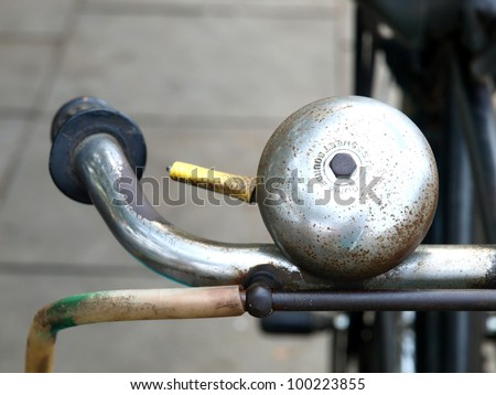 the isolated original bicycle bell - stock photo
