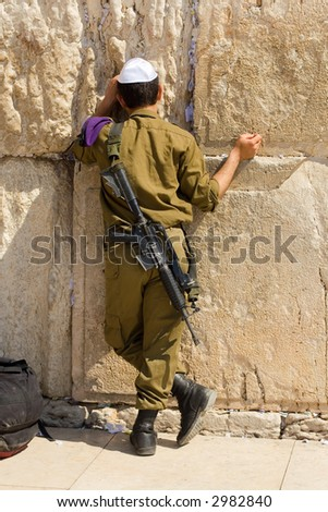 The Israeli soldier prays at the western wall. Jerusalem, Israel. - stock photo