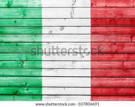 The Italian flag painted on wooden fence - stock photo