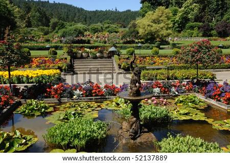 The italian garden inside the historic butchart gardens (built in 1904), vancouver island, british columbia, canada - stock photo