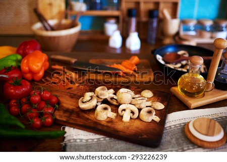 The Italian restaurant will cook the vegetables to feed their meat, sliced mushrooms, tomatoes, carrot slices - stock photo