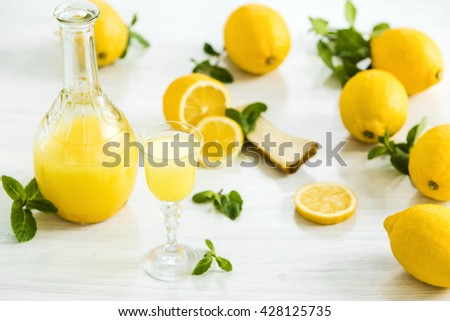 The italian traditional liqueur limoncello with lemon