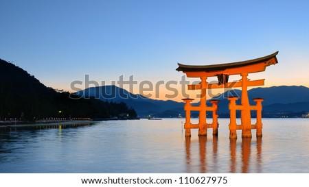 The Itsukushima floating Torii Gate off the coast of the island of Miyajima, Hiroshima, Japan. - stock photo
