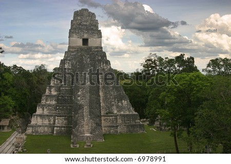 The Jaguar temple and empty central plaza at Tikal, early evening. Guatemala, Central America