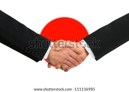 The Japan flag and business handshake - stock photo