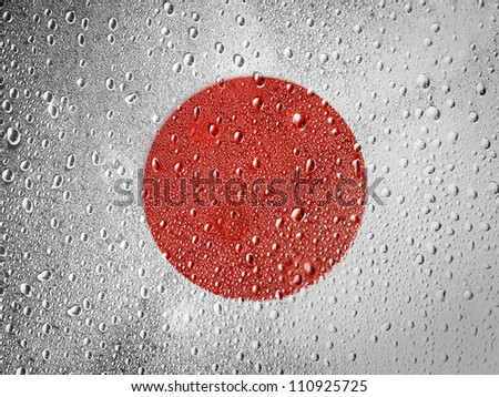 The Japan flag painted on metal surface covered with rain drops - stock photo