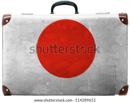 The Japan flag painted on  old grungy travel suitcase or trunk - stock photo