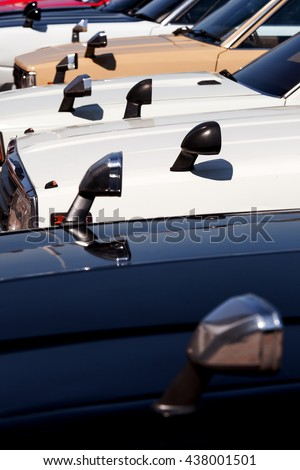 The Japanese cars built in a row mirrors on a wing of the old car. - stock photo
