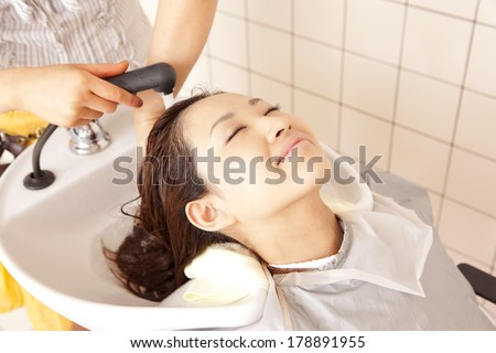 The Japanese woman who has a beautician wash hair - stock photo