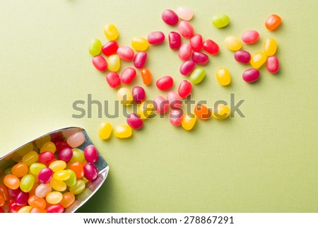 the jelly beans on green table - stock photo