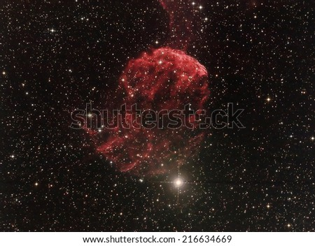 the Jellyfish Nebula is a Galactic supernova remnant (SNR) in the constellation Gemini.Its distance is roughly 5,000 light years from Earth.IC443