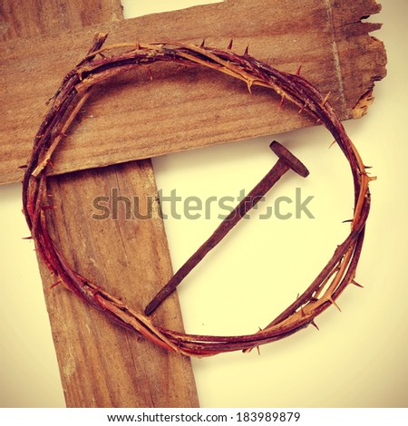 the Jesus Christ crown of thorns and the Holy Cross, with a retro effect - stock photo