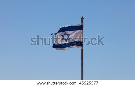 The Jewish flag fluttering on the house - stock photo