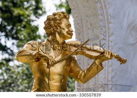 the johann strauss monument stands in the vienna city park. - stock photo