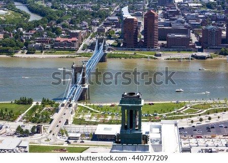 The John A. Roebling Bridge connects Cincinnati, Ohio and Covington, Kentucky over the Ohio river.  Built in 1867, the bridge is on the National Register of Historic Places. - stock photo