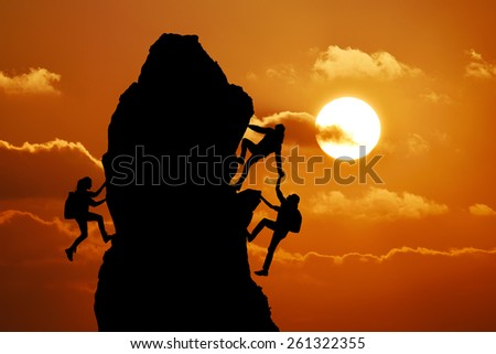 The joint work teamwork of two men travelers and girl help each other on top of a mountain climbing team, a beautiful sunset landscape - stock photo