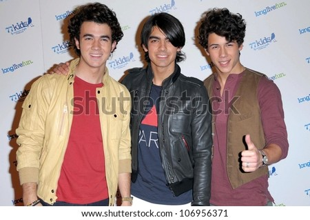 The Jonas Brothers  at the Launch party for 77kids clothing line by American Eagle. The Roxy, Los Angles, CA. 11-14-08 - stock photo