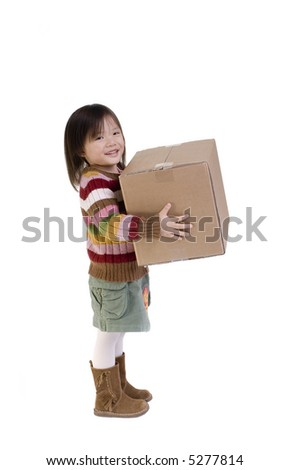 The joys of moving from one place to another. A young girl carries a moving box. - stock photo
