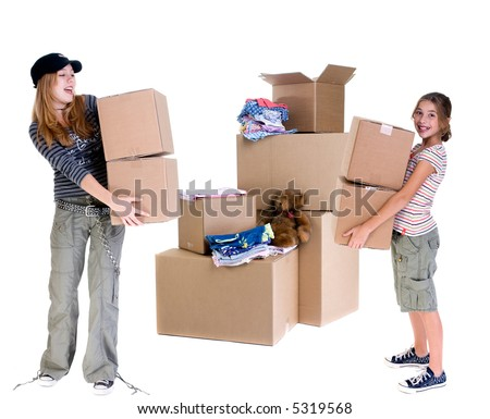 The joys of moving from one place to another. Two sisters pack up their rooms - stock photo