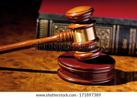 the judge hammer a judge in court. located on a desk. - stock photo
