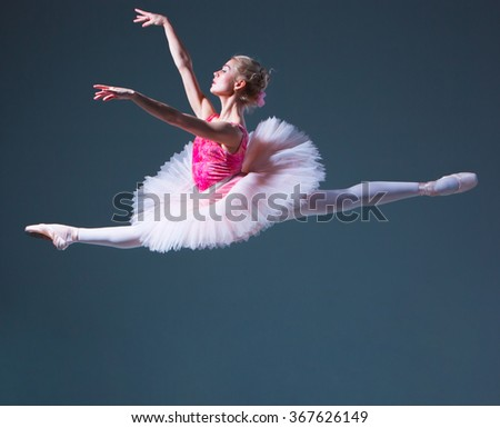 The jump of beautiful female ballet dancer  - stock photo