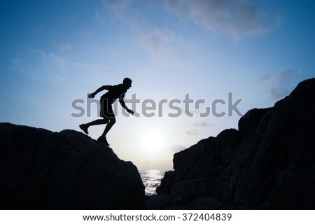 The jumping man on rocks