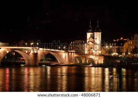 The Karl Theodor Bridge on the river in Heidelberg (Germany), before the fireworks celebrations for the Castle start - stock photo