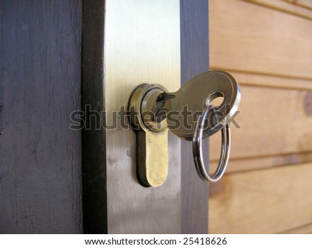 The key in the door lock - stock photo