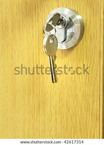 The key is in a door lock - stock photo