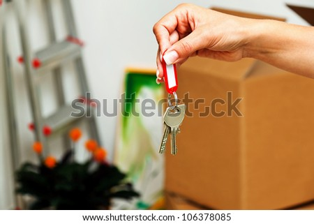 the key to an apartment with the move. new tenant moves. - stock photo