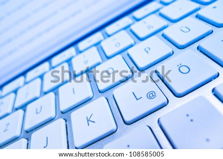the keyboard of a computer from a screen. computer and internet - stock photo