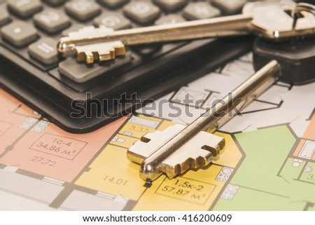 The keys and layout of a new apartment - stock photo