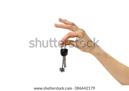 The keys in female hand isolated on white