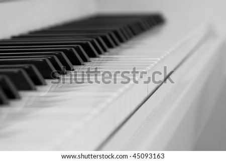 The keys of a piano in black and white. - stock photo