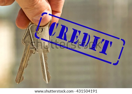 "The keys to the apartment and the stamp ""credit"" against the backdrop of houses - stock photo"