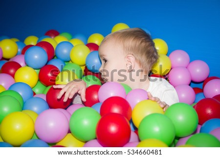 The kid in a balls pool