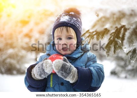 the kid in the winter on walk - stock photo