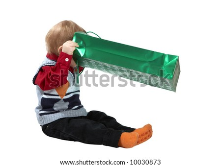 The kid opens a package - stock photo