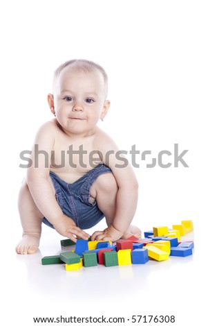 The kid plays with cubes on a white background - stock photo