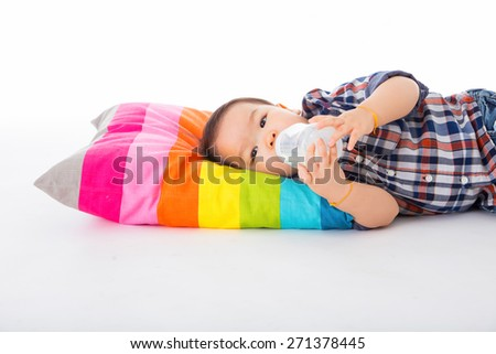 The kids are sleeping, eating milk on a white background. - stock photo