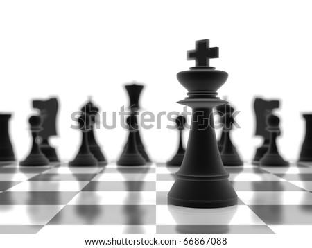 The king chess piece standing in-focus, infront of the rest of the pieces - stock photo