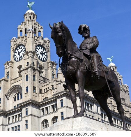 The King Edward VII Monument with the Liver Building in the background.  Liverpool, England. - stock photo