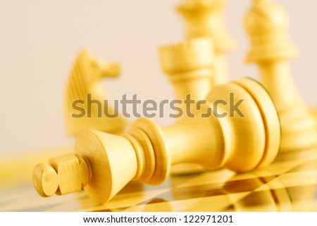 The king is checkmated, game of chess comes to an end - stock photo