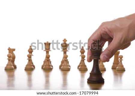 the king piece of a chess table ready for it's move (selective focus) - stock photo
