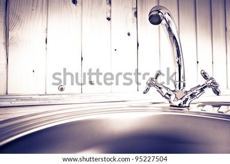 The kitchen water crane - stock photo