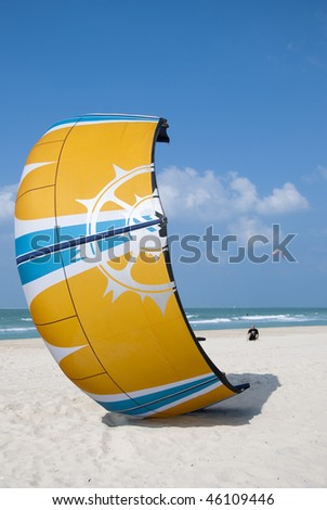 The kite surfer preparing the take off of his kite - stock photo