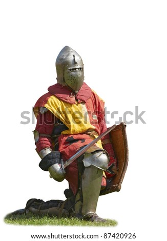 The knight in an armor, standing on one knee, with we throw also a board, isolated on a white background - stock photo